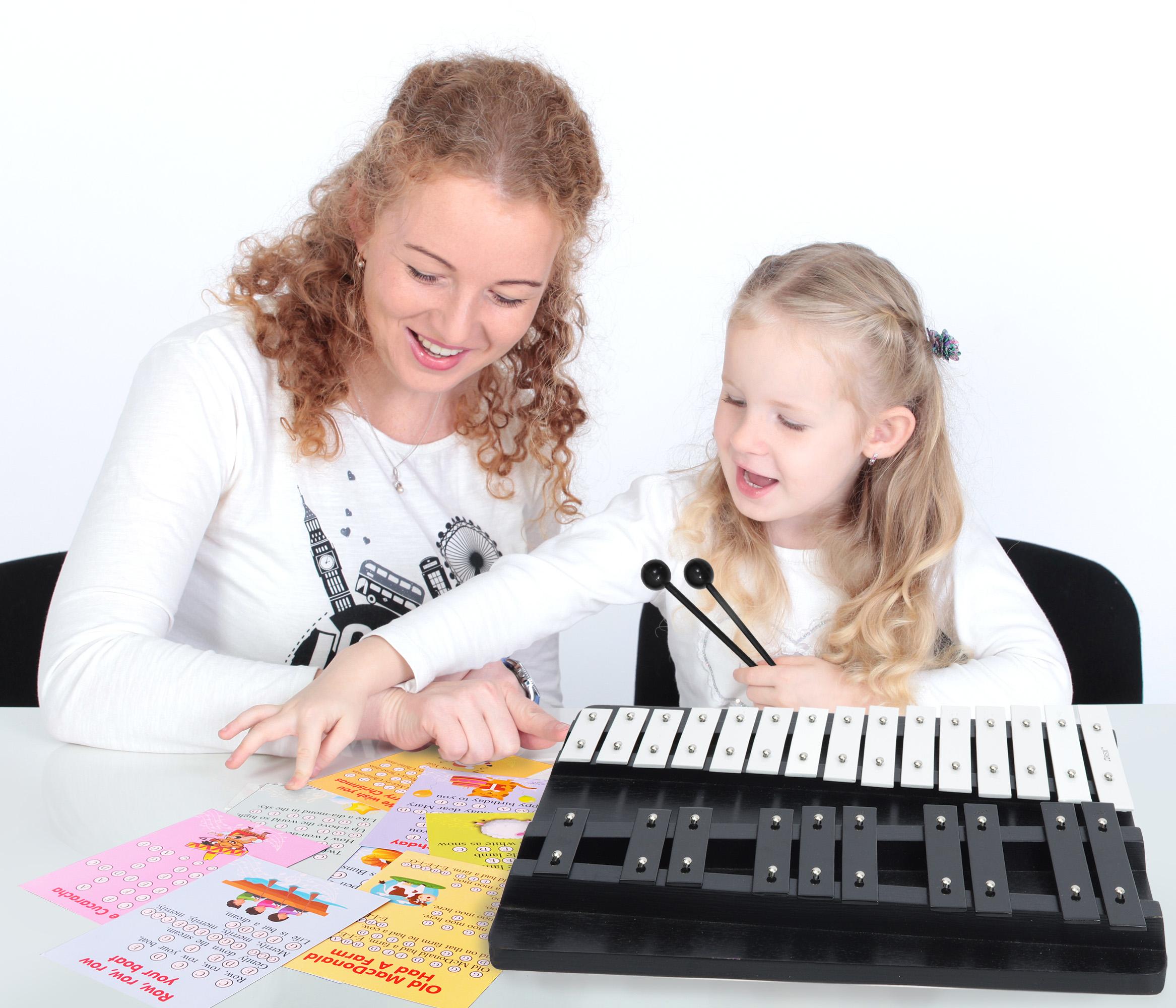 girl plays xylophone
